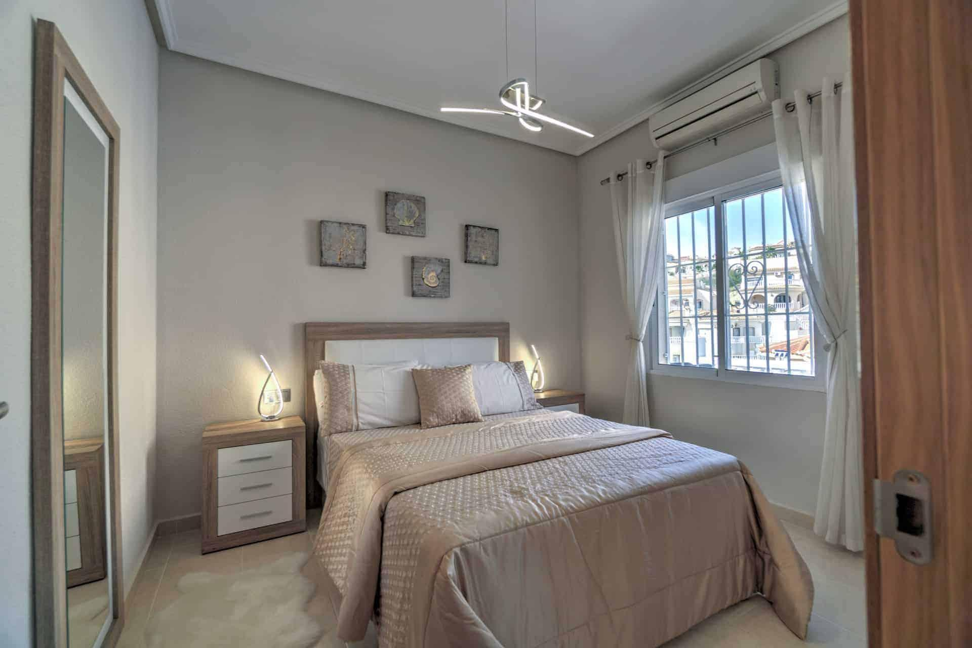 real estate photograph of stylish bedroom
