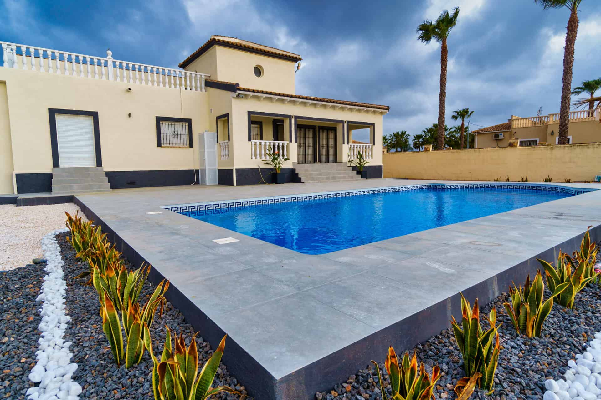 exterior property shot of garden and pool